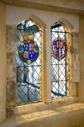 Символы  королевской власти на окнах в Palace  of Placentia